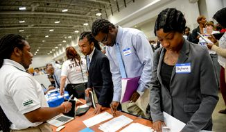 Left to right: Donnell Davis, Carl Tucker, and Stephanie Stewart all of of Washington, D.C. speak with Department of Public Works Recruiting Lead Dominique Odesola, left, during Mayor GrayÕs 2014 Citywide Hiring Fair at the Walter E. Washington Convention Center, Washington, D.C., Wednesday, July 30, 2014. (Andrew Harnik/The Washington Times) **FILE**