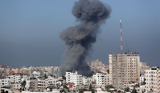 Smoke from the explosion of an Israeli strike rise over Gaza City, Wednesday, July 30, 2014, amid Israel's heaviest air and artillery assault in more than three weeks of Israel-Hamas fighting. (AP Photo/Khalil Hamra)