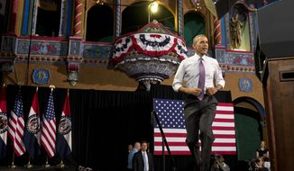 President Barack Obama arrives to speak about the economy, Wednesday, July 30, 2014, at the Uptown Theater in Kansas City, Mo. (AP Photo/Jacquelyn Martin)