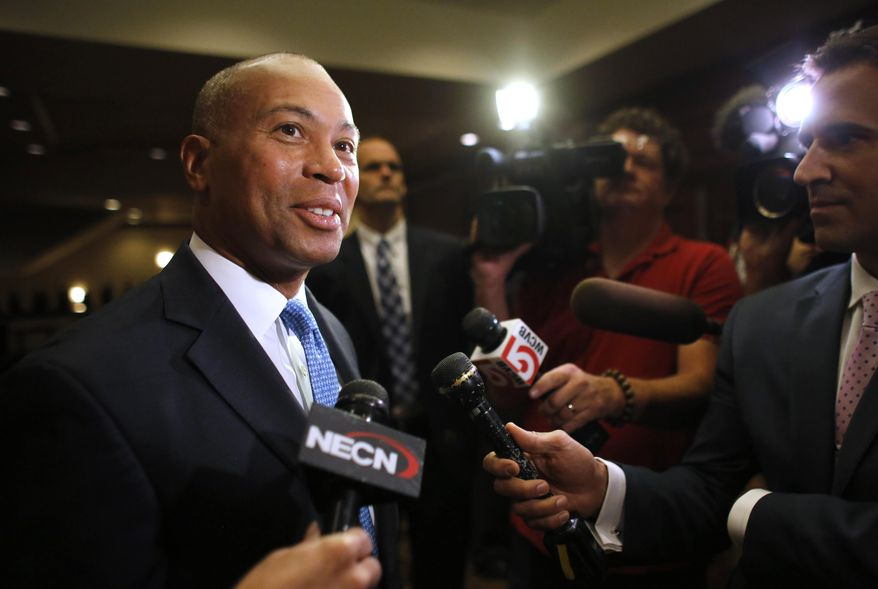 ** FILE ** Massachusetts Gov. Deval Patrick speaks with members of the media in a hallway of a hotel at the National Association of Black Journalists convention, Thursday, July 31, 2014, in Boston. Patrick addressed an audience at the convention. (AP Photo/Steven Senne)