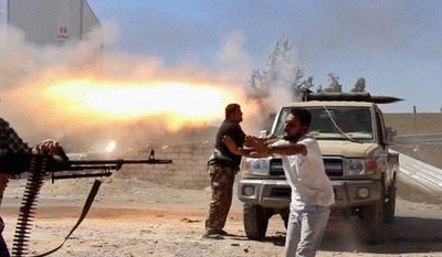 Fighters from the Islamist Misarata brigade have been battling for two weeks near Tripoli International Airport in an attempt to wrest control from a powerful rival militia. (Associated Press)