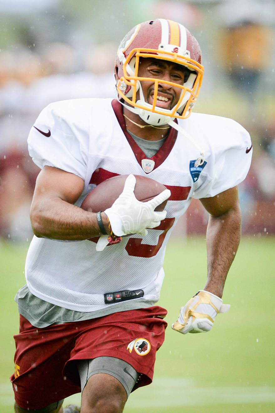 Washington Redskins running back Lache Seastrunk (35) runs a drill on the opening day of Washington Redskins Training Camp at Bon Secours Training Center, Richmond, Va., Thursday, July 24, 2014. (Andrew Harnik/The Washington Times)