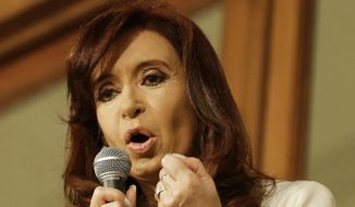Argentine President Cristina Fernandez gives a speech to supporters from a balcony at an inside patio of Casa Rosada Presidential Palace in Buenos Aires, Argentina, Thursday, July 31, 2014. The collapse of talks with U.S. creditors sent Argentina into its second debt default in 13 years and raised questions about what comes next for financial markets and the South American nation's staggering economy.(AP Photo/Victor R. Caivano)