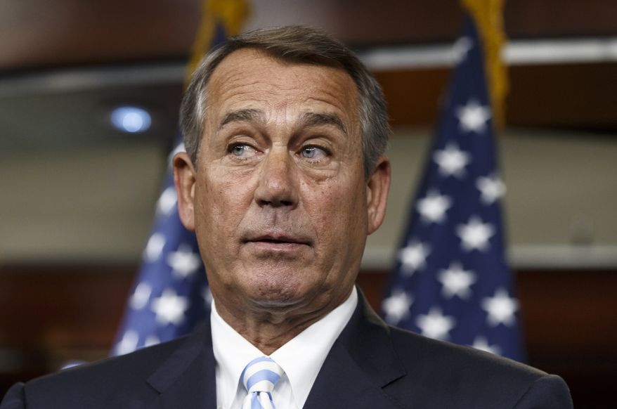 House Speaker John Boehner of Ohio defends the work of the GOP during a brief news conference on Capitol Hill in Washington, Thursday, July 31, 2014, as Congress prepares to leave for a five-week summer recess. The institutional split of a Republican-led House and Democratic-controlled Senate has added up to inaction, especially in a midterm election year with control of the Senate at stake. Lawmakers have struggled to compromise on a handful of bills to deal with the nation's pressing problems amid overwhelming partisanship.   (AP Photo/J. Scott Applewhite)