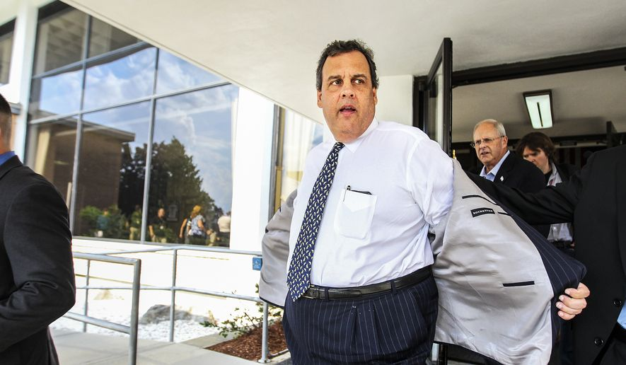 New Jersey Gov. Chris Christie, center, heads out of BAE Systems in Nashua, N.H. after stumping for Republican candidate for governor of New Hampshire, Walt Havenstein, second from right, on Thursday, July 31, 2014. Christie has been traveling around the country boosting Republican candidates in his role as chair of the Republican Governors Association. (AP Photo/Cheryl Senter)