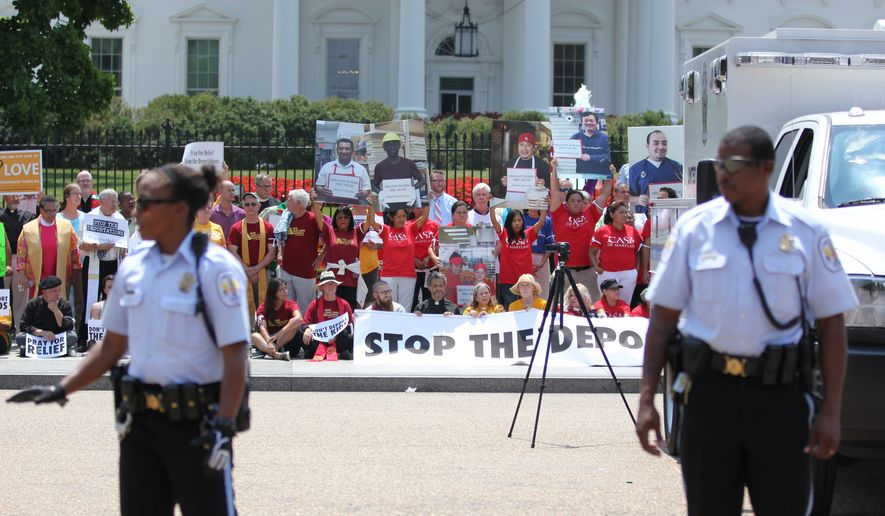 Faith leaders and activists participate in a demonstration in front of the White House in Washington, Thursday, July 31, 2014, asking President Barack Obama to modify his deportations policies. (AP Photo/Connor Radnovich)