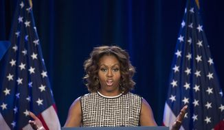 First lady Michelle Obama speaks at the 2014 National Conference on Ending Homelessness, part of the Joining Forces initiative,  Thursday, July 31, 2014,  in Washington. (AP Photo/Cliff Owen)