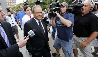 Surrounded by reporters, former Star Scientific CEO Jonnie Williams leaves federal courthouse in Richmond, Va., after testifying Thursday, July 31, 2014. During his testimony, Williams detailed a pattern of requests for gifts by former first lady Maureen McDonnell and a loan that former Gov. Bob McDonnell asked for. (AP Photo/Richmond Times-Dispatch, Dean Hoffmeyer)