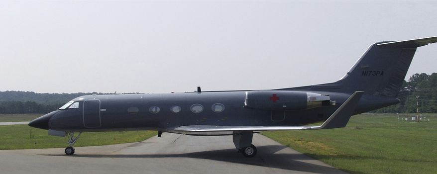 """In this undated photo released by the Center for Disease Control, a Gulfsteam airplane modified to carry a Aeromedical Biological Containment System, which looks like a sealed isolation tent for Ebola air transportation, is shown. On Thursday afternoon July 31, 2014, officials at Atlanta's Emory University Hospital said they expected one of the Americans to be transferred there """"within the next several days."""" The hospital declined to identify which aid worker, citing privacy laws. (AP Photo/Center for Disease Control)"""