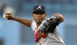 Atlanta Braves starting pitcher Julio Teheran throws to the plate during the first inning of a baseball game against the Los Angeles Dodgers, Thursday, July 31, 2014, in Los Angeles. (AP Photo/Mark J. Terrill)