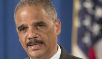 ** FILE ** This July 14, 2014, file photo shows Attorney General Eric Holder speaking at the Justice Department in Washington. (AP Photo/Pablo Martinez Monsivais, File)