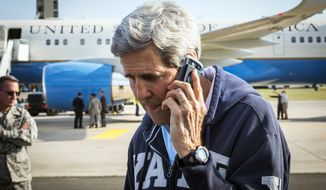 "U.S. Secretary of State, John Kerry, centre, speaks on his phone while his plane refuels at Ramstein Air Base in Ramstein-Miesenbach, Germany, Friday, Aug. 1, 2014. The United States on Friday condemned ""in the strongest possible terms"" the attack by Palestinian militants that killed two Israeli soldiers and led to the apparent abduction of another. ""It was an outrageous violation of the cease-fire negotiated over the past several days, and of the assurances given to the United States and the United Nations,"" Secretary of State John Kerry said in a statement. (AP Photo/Lucas Jackson, Pool)"