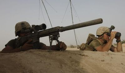 ** FILE ** Members of U.S. Marine Scout-Sniper team look for a Taliban position in a nearby tree-line, during an exchange of fire with Taliban militants, in Helmand province, southern Afghanistan, Saturday, Aug. 27, 2011. (AP Photo/Brennan Linsley)