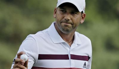 Sergio Garcia, from Spain, waves to the crowd after a birdie on the second hole during the third round of the Bridgestone Invitational golf tournament Saturday, Aug. 2, 2014, at Firestone Country Club in Akron, Ohio. (AP Photo/Mark Duncan)
