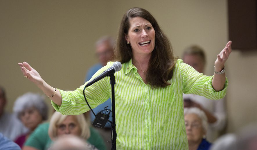 ** FILE ** U.S. Senate candidate and Kentucky Secretary of State Alison Lundergan Grimes, D-Ky., rallies a group of supporters during a campaign stop in Brandenburg, Ky., on Wednesday, July 30, 2014. (AP Photo/David Stephenson)