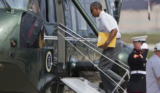 President Barack Obama boards the Marine One helicopter at Andrews Air Force Base, Md., Saturday, Aug. 2, 2014, en route to a weekend in Camp David. (AP Photo/Manuel Balce Ceneta)