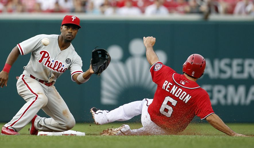Philadelphia Phillies shortstop Jimmy Rollins waits for the throw as Washington Nationals' Anthony Rendon safely steals second base during the first inning of a baseball game at Nationals Park Saturday, Aug. 2, 2014, in Washington. (AP Photo/Alex Brandon)