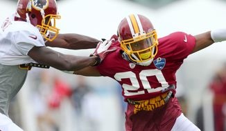 Washington Redskins cornerback Richard Crawford (20) defends wide receiver Rashad Lawrence (17), left, during practice at a NFL football training camp, Saturday, AUg. 2, 2014 in Richmond, Va. (AP Photo/Richmond Times-Dispatch, Daniel Sangjib Min)