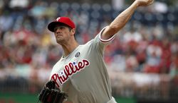 Philadelphia Phillies starting pitcher Cole Hamels throws during the first inning of a baseball game against the Washington Nationals at Nationals Park Sunday, Aug. 3, 2014, in Washington. (AP Photo/Alex Brandon)