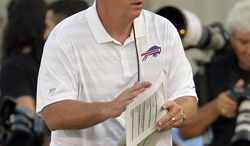 Buffalo Bills head coach Doug Marrone watches in the first quarter against the New York Giants at the Pro Football Hall of Fame exhibition NFL football game Sunday, Aug. 3, 2014, in Canton, Ohio. (AP Photo/David Richard)