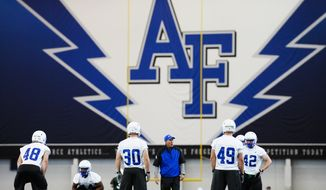 **FILE** The Air Force Academy defensive line takes to the field for drills on the first day of football practice for the 2014 season Thursday, July 31, 2014 at the Holaday Athletic Center in Colorado Springs, Colo. (AP Photo/The Colorado Springs Gazette, Michael Ciaglo)