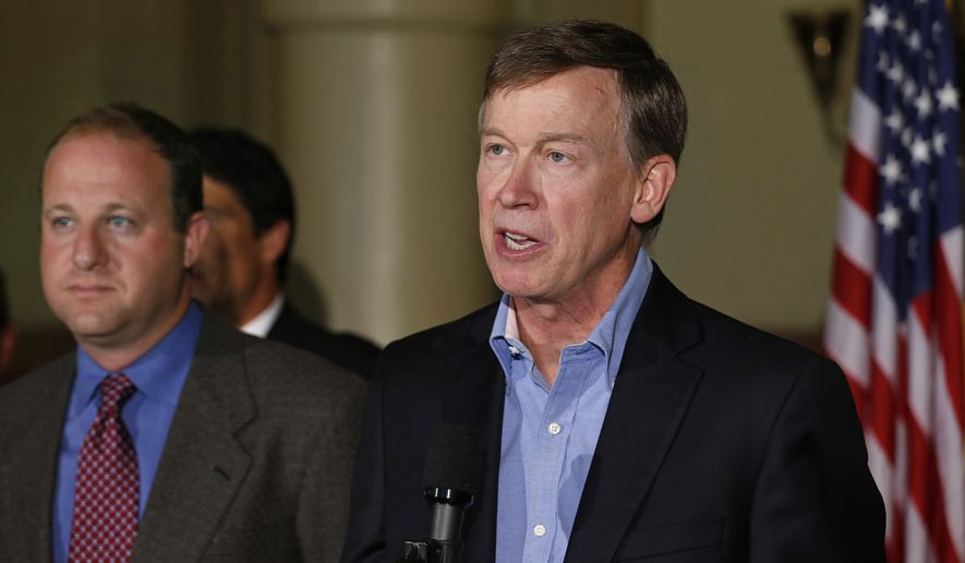 Colo. Gov. John Hickenlooper, right, speaks as U.S. Rep. Jared Polis, D-Colo., left, stands nearby, during a news conference about fracking, at the Capitol in Denver, Monday Aug. 4, 2014. (AP Photo/Brennan Linsley) ** FILE **