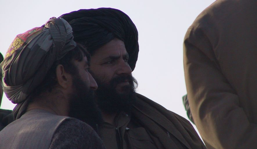 Mullah Mohammad Fazl, center, in black turban, during hilltop surrender negotiations in Afghanistan in November 2001. Photo courtesy of U.S. Special Operations Command
