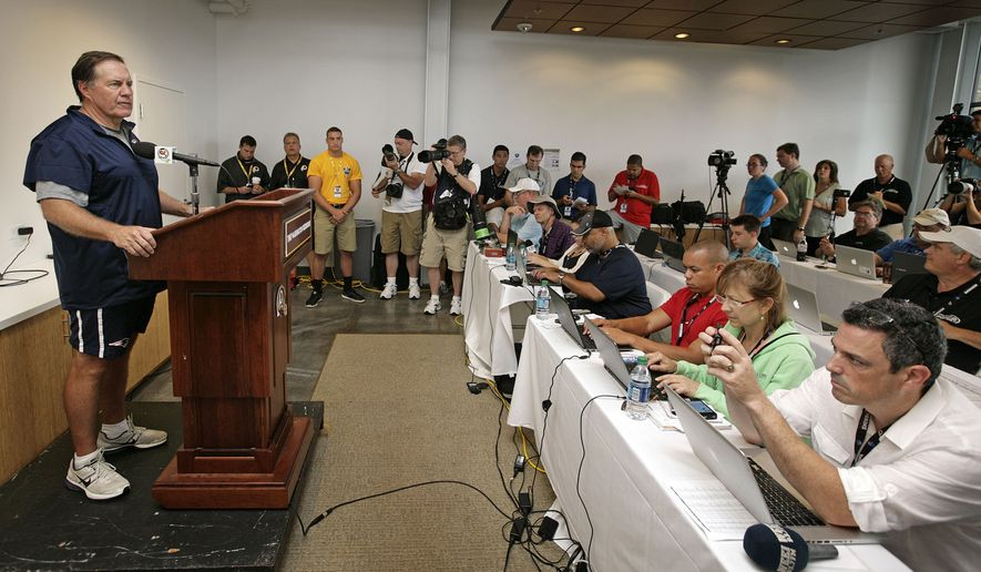 New England Patriots NFL football head coach Bill Belichick speaks at a press conference at a joint New England Patriots and Washington Redskins practice in Richmond, Va., Monday, Aug. 4, 2014. (AP Photo/Jay Paul)