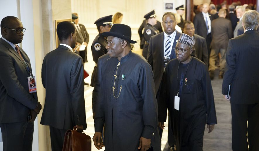Nigeria's President Goodluck Jonathan, center, departs a reception for leaders attending the US-Africa Summit on Capitol Hill in Washington, Monday, Aug. 4, 2014.  The gathering was hosted by the Senate Foreign Relations Committee and the House Foreign Affairs Committee. President Barack Obama and his administration are trying to strengthen ties with Africa, grappling with issues such as investment, poverty, terrorism, corruption and deadly diseases.   (AP Photo/J. Scott Applewhite)