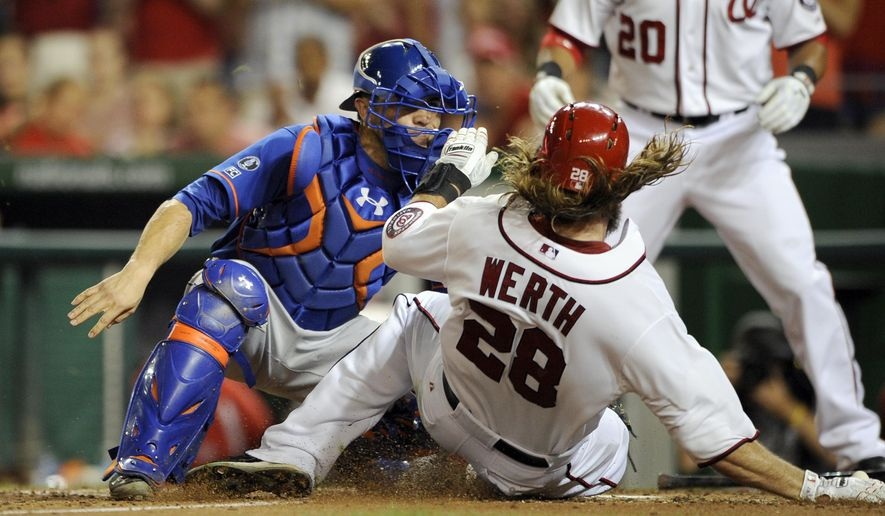 Washington Nationals' Jayson Werth (28) is tagged out at the plate by New York Mets catcher Travis d'Arnaud, left, during the sixth inning of a baseball game, Tuesday, Aug. 5, 2014, in Washington. (AP Photo/Nick Wass)