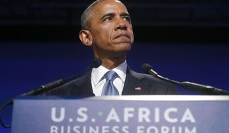 President Barack Obama pauses as he speaks at the US Africa Business Forum during the US Africa Leaders Summit, Tuesday, Aug. 5, 2014, at the Mandarin Oriental Hotel in Washington. African heads of state are gathering in Washington for an unprecedented summit to promote business development. (AP Photo/Charles Dharapak)