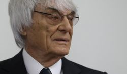 Formula One boss Bernie Ecclestone arrives for his trial in the regional court in Munich, southern Germany, Tuesday, Aug. 5, 2014. Ecclestone has been been on trial since April on charges of bribery and incitement to breach of trust. The charges involve a $44 million payment to banker Gerhard Gribkowsky, who's serving an 8 1/2-year sentence for taking the money. (AP Photo/Matthias Schrader)