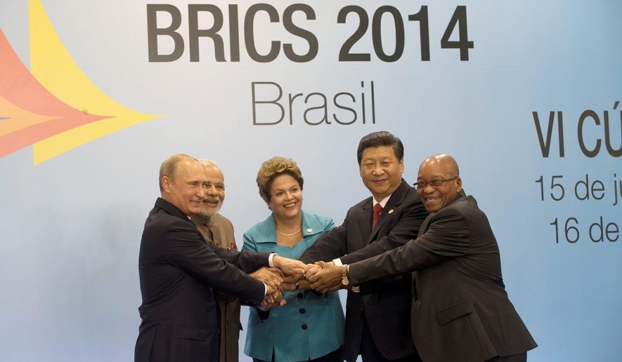 Leaders of the BRICS nations pose for a group photo during the summit in Fortaleza, Brazil, in July. From left: Russian President Vladimir Putin, Indian Prime Minister Narendra Modi, Brazilian President Dilma Rousseff, Chinese President Xi Jinping and South African President Jacob Zuma. The leaders of the BRICS nations are expected to officially create a bailout and development fund worth $100 billion. (Associated Press)