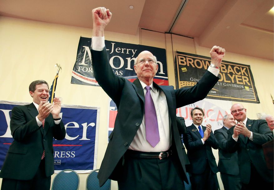 Sen. Pat Roberts of Kansas greets a crowd of cheering supporters Tuesday while watching primary votes come in at the Overland Park, Kan., Marriott Hotel. (Associated Press)