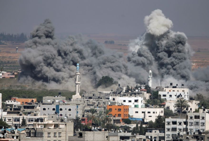 Smoke rises after an Israeli strike in Gaza City, northern Gaza Strip in July 31, 2014. With the U.S. and other countries trying to mediate a durable cease-fire between Israel and Hamas, another enthusiasm gap between the parties is emerging this midterm year, this one targeting the shifting feelings about the deep U.S. alliance with Israel. (Associated Press)