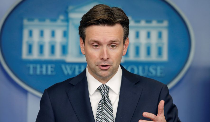 White House press secretary Josh Earnest says that Congress should take the necessary steps to close the loopholes that American companies use to move their headquarters overseas as a way to avoid paying corporate taxes. (associated press)