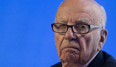 In this July 17, 2014 photo, Rupert Murdoch, executive chairman of News Corporation, listens to a question during a panel discussion at the B20 meeting of company CEOs in Sydney, Australia. (AP Photo/Jason Reed, Pool, File)