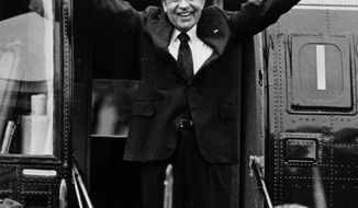 In this Aug. 9, 1974 photo, Richard Nixon waves goodbye with a salute to his staff members outside the White House as he boards a helicopter and resigns the presidency on Aug. 9, 1974. He was the first president in American history to resign the nation's highest office. (AP Photo, File)