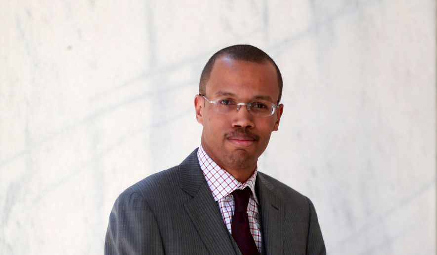 This March 20, 2014 photo shows Chaka Fattah Jr in Philadelphia.  Fattah Jr.has been indicted and charged with bank fraud, tax evasion and misspending federal education funds. The federal indictment unsealed Tuesday, Aug. 5, 2014,  accuses Chaka Fattah Jr. of lying about his income to obtain more than $200,000 in business loans he then spent on personal expenses, gambling debts and legal fees.  Fattah Jr., 31, is the son of Philadelphia congressman Chaka Fattah.  (AP Photo/The Philadelphia Inquirer, David Swanson)  PHIX OUT; TV OUT; MAGS OUT; NEWARK OUT