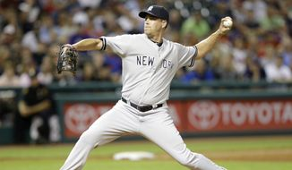 New York Yankees relief pitcher Matt Thornton delivers in the seventh inning of a baseball game against the Cleveland Indians Tuesday, July 8, 2014, in Cleveland. (AP Photo/Tony Dejak)