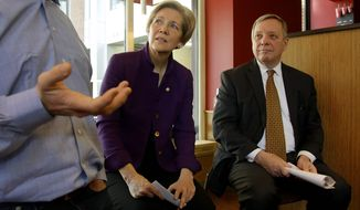 **FILE** Sen. Elizabeth Warren, D-Mass., center, and Senate Majority Whip Richard Durbin of Ill., right, listen as Boloco founder John Pepper speaks during a minimum wage roundtable discussion held at Boloco. a fast food chain of burrito restaurants in Boston, Monday, Feb. 10, 2014. Boloco pays a minimum wage of $9.00 per hour while the current federal minimum is $7.25 per hour. (AP Photo/Stephan Savoia)