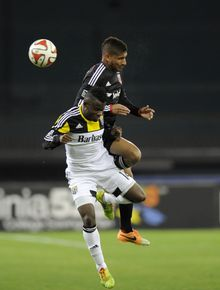 D.C. United defender Sean Franklin, top, vies for the ball against Columbus Crew defender Waylon Francis during the second half of an MLS soccer game, Saturday, March 8, 2014, in Washington. Columbus won 3-0. (AP Photo/Nick Wass)