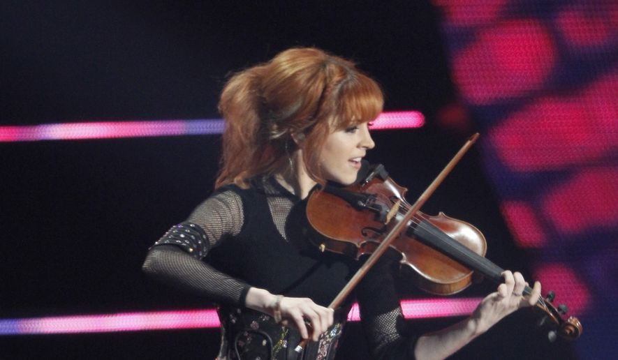 Lindsey Stirling performs on stage at the CMT Music Awards at Bridgestone Arena on Wednesday, June 4, 2014, in Nashville, Tenn. (Photo by Wade Payne/Invision/AP)