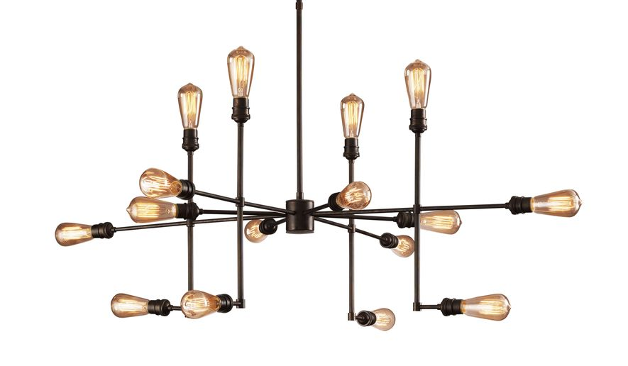 This photo provided by Restoration Hardware shows the Varick chandelier which is as much a sculptural piece as it is lighting.  A constellation of industrial-type fittings house vintage-look filament bulbs. (AP Photo/Restoration Hardware)