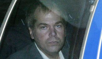 John Hinckley, shot President Ronald Reagan in 1981, was ruled legally insane at the time of the shooting and was sent to a state mental hospital. He will be allowed unsupervised visits with his mother.  (AP Photo/Evan Vucci, File)