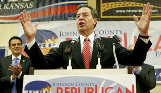 Kansas Governor Sam Brownback hypes up a crowd of republicans after polls closed on Tuesday, Aug. 5, 2014, while watching the primary votes come in at a republican gathering in the Overland Park, Kan., Marriott Hotel. (AP Photo/Topeka Capital-Journal, Chris Neal)