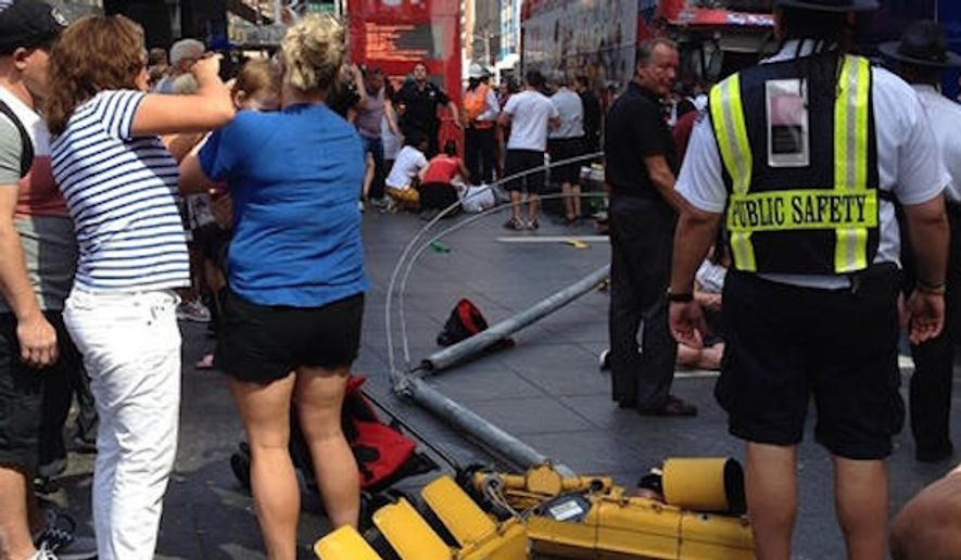 Emergency responders are on the scene of a double-decker bus crash in Times Square. (NBC4/@jprice141788/Instagram)