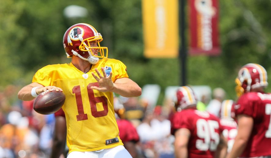 Washington Redskins QB Colt McCoy tosses a pass before an NFL Football training camp scrimmage of New England Patriots and  Washington Redskins in Richmond, Va., Tuesday, Aug. 5, 2014.   (AP Photo/Skip Rowland)
