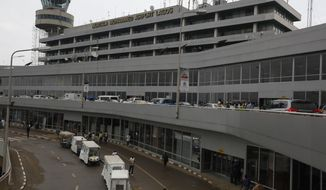 ** FILE ** Passengers are seen at the Murtala Muhammed International Airport in Lagos, Nigeria, Monday, Aug. 4, 2014. Nigerian authorities on Monday confirmed a second case of Ebola in Africa's most populous country, an alarming setback as officials across the region battle to stop the spread of a disease that has killed more than 700 people. (AP Photo/Sunday Alamba)