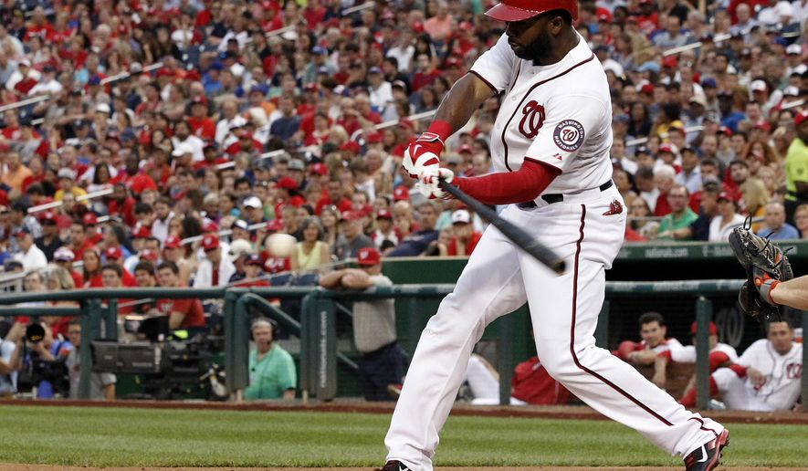 Washington Nationals' Denard Span hits a single during the third inning of a baseball game against the New York Mets at Nationals Park Wednesday, Aug. 6, 2014, in Washington. (AP Photo/Alex Brandon)